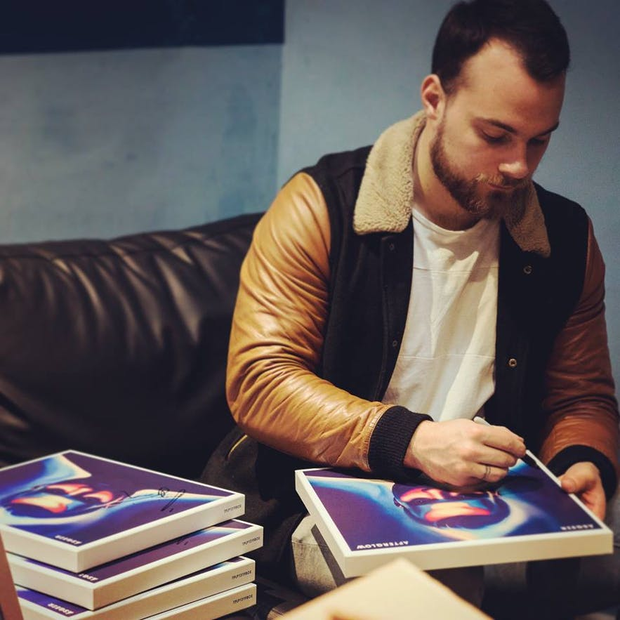 Ásgeir signing promotional copies of 'Afterglow'
