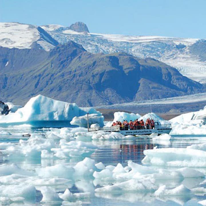 A boat sails on Jökulsárlón Glacier Lagoon.