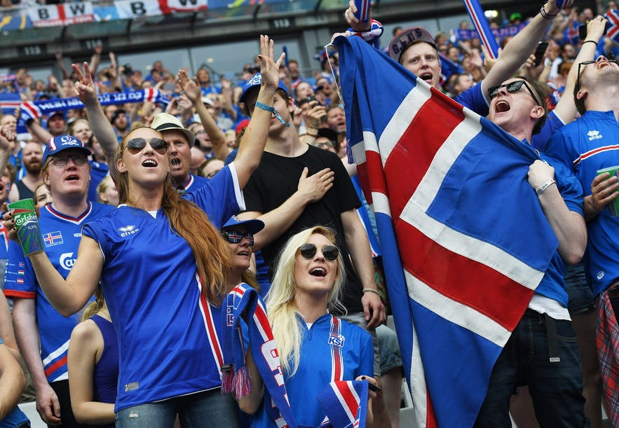 Icelandic football fans sporting their national colours.