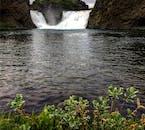 The waterfall Hjálparfoss in the Icelandic Highlands falls down beautiful cliffs of basalt.
