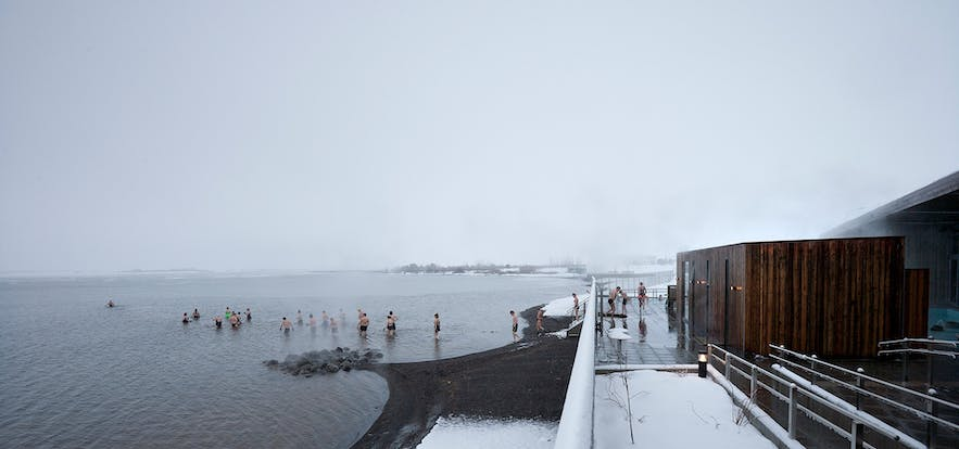 People cooling off in Laugarvatn lake after a visit to the hot tubs or steam rooms
