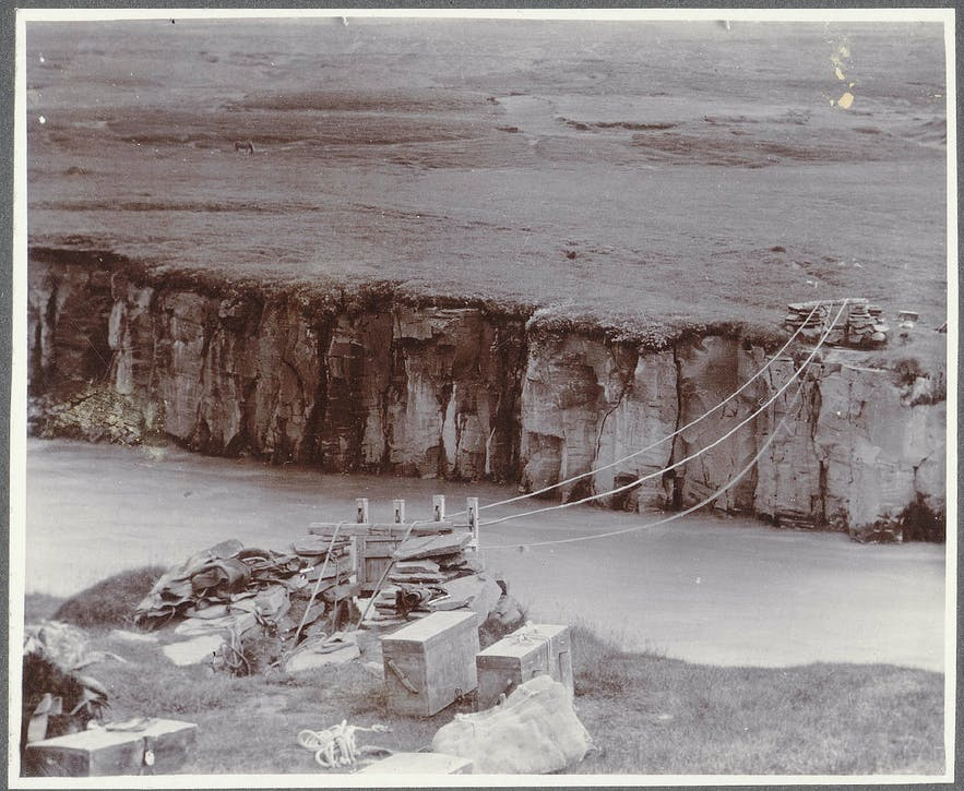 An old rope bridge crossing the river. Photograph taken by Frederick W.W. Howell.