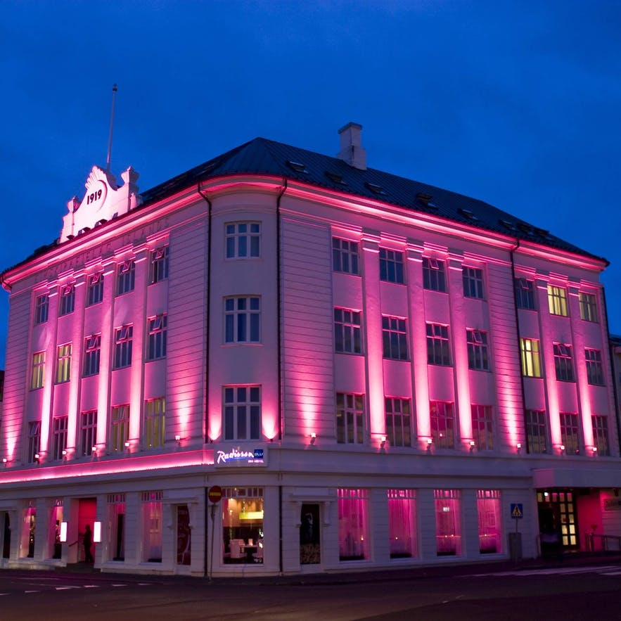 Radisson Blu 1919 Hotel, lit in the colours of the aurora