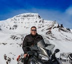 Witness the incredible mountains of North Iceland in winter from the back of a snowmobile.