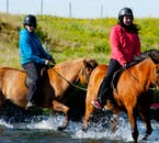 Crossing a South Iceland river on the back of a horse.