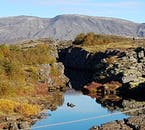 Þingvellir is dominated with cracks and glacial fissures, carving through the picturesque landscape. The most famous of these is Silfra Fissure.