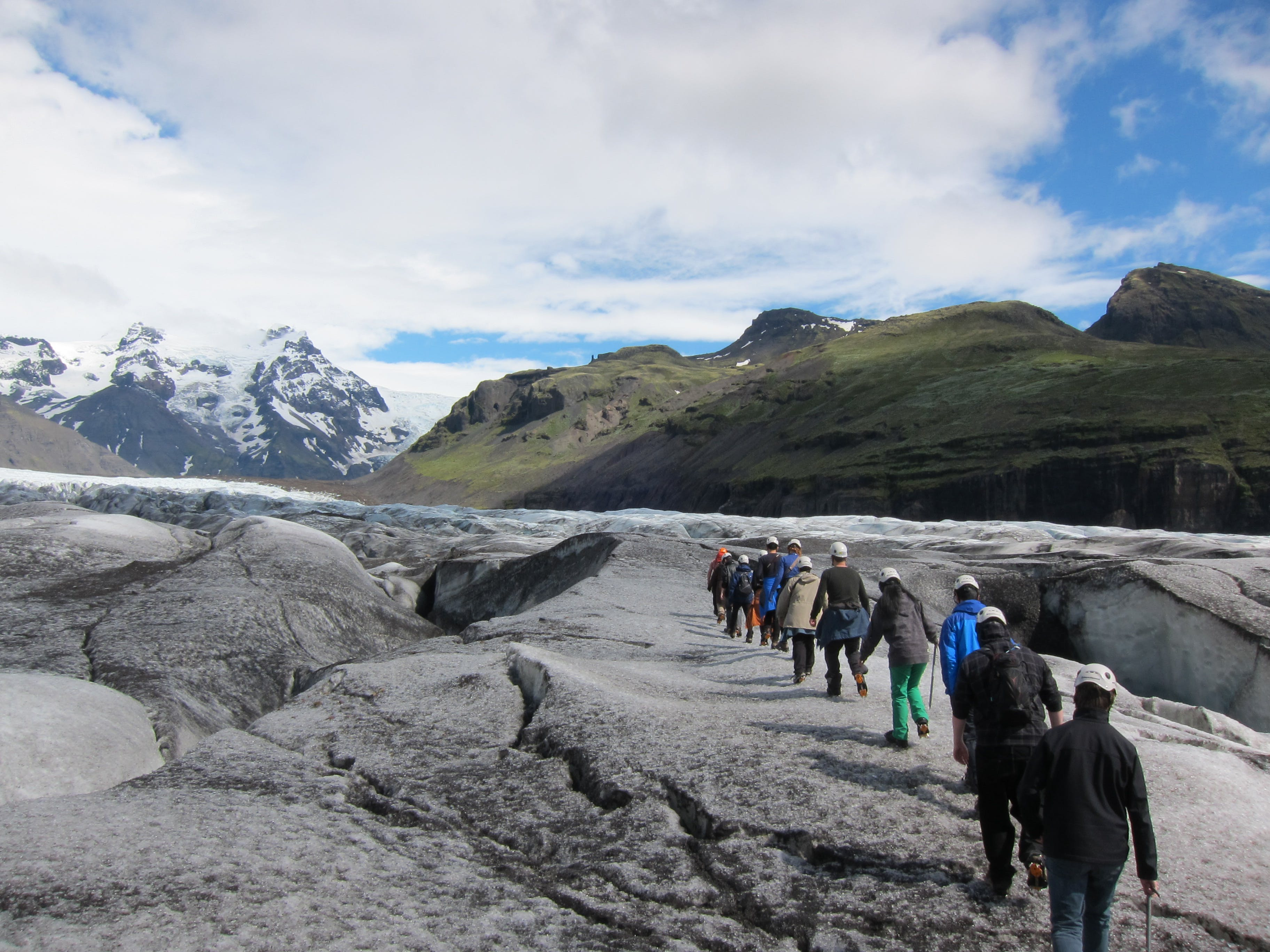Glacier hikers on Svínafellsjökull, striding from Skaftafell Nature Reserve towards the mighty Vatnajökull.