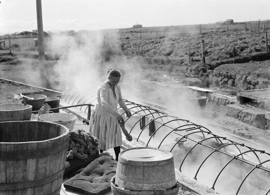 An Icelandic woman by Reykjavík's Þvottalaugar ('Washing Pools'), early 20th century.