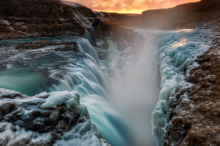 Gullfoss waterfall on the Golden Circle unleashes a spray of glacial water throughout the year.