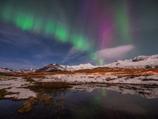Iceland's snowy landscapes in winter provide a frozen wonderland above which you can marvel over the aurora borealis.