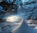 A pyramid of snow sits within one of Iceland's most beautiful locations, its blue ice cave, beneath Vatnajökull.