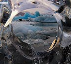 A window through crystal clear ice in Jökulsárlón reveals just a slither of the glacier lagoon's immense beauty.