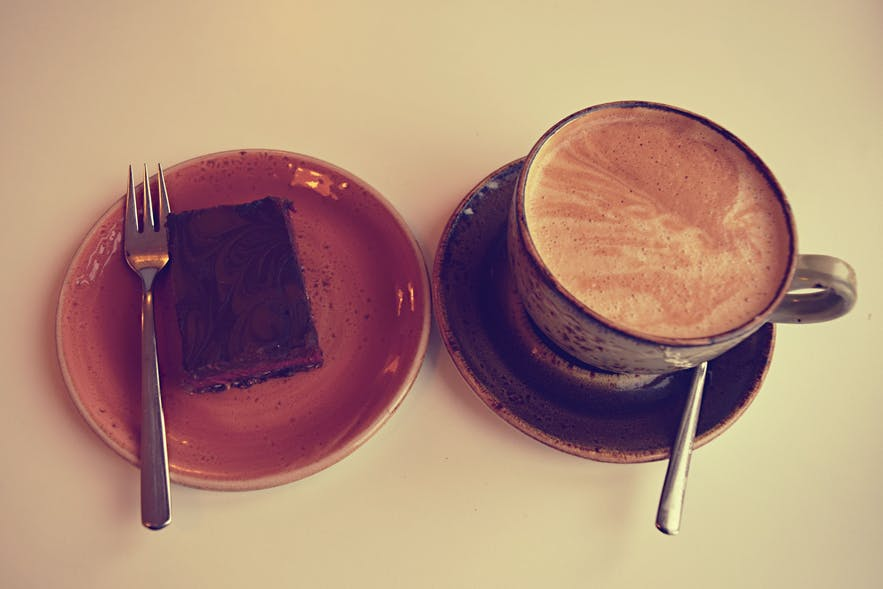 Raw vegan raspberry brownie with vegan latte at Glo