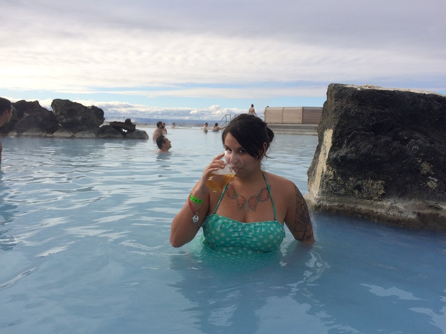Enjoying an Icelandic beer in a natural spa