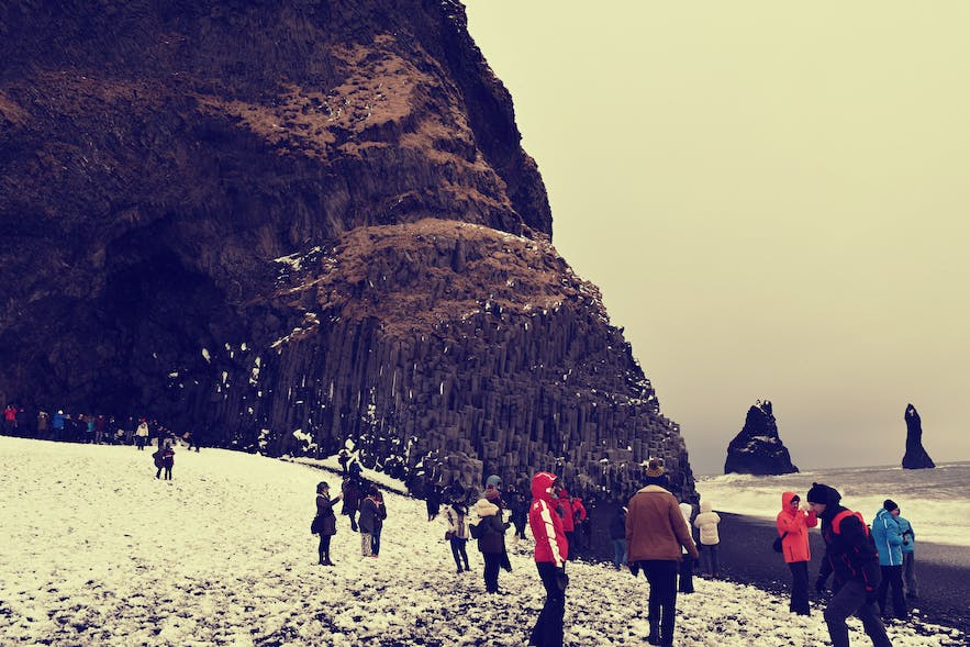 Tourists crowd Vik's Black Sand Beach