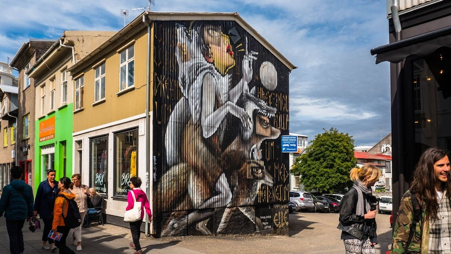 A mural on a corrugated iron house gives alternate effects as opposed to a barren wall