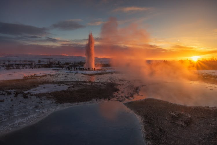 The mighty Strokkur geyser routinely erupts every five to ten minutes, spouting enormous amounts of water high into Iceland's winter sky.