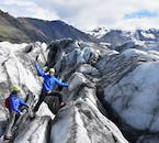 Glacier hikers celebrating their ascent in Skaftafell Nature Reserve.