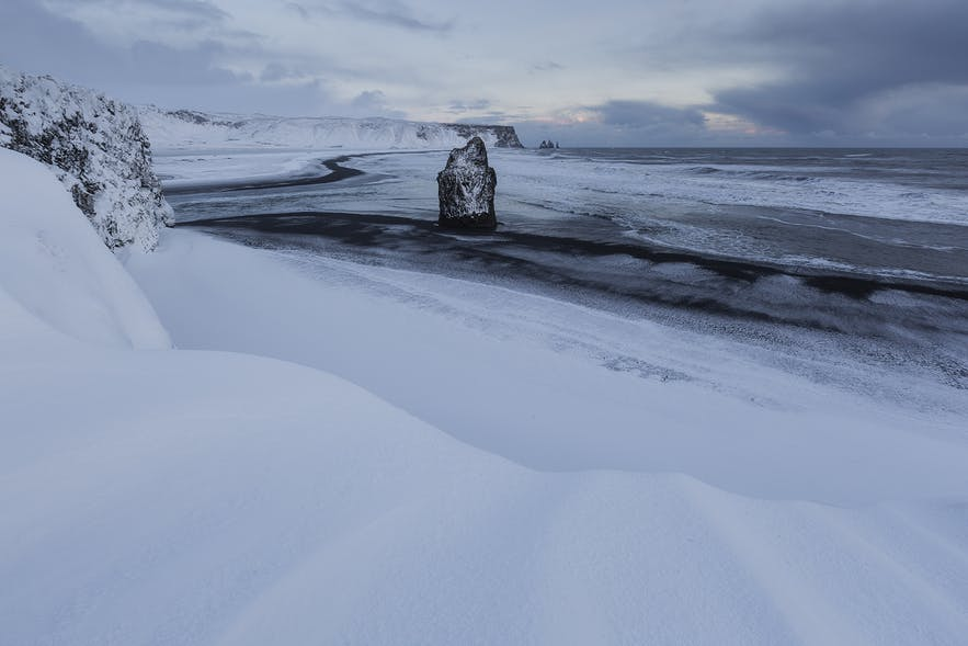 Reynisfjara beach, covered in snow, is more dangerous in winter than usually.