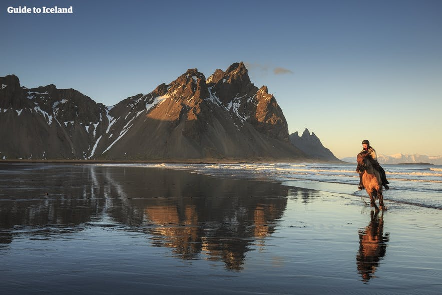 Horse riding near Vestrahorn in south-east Iceland.