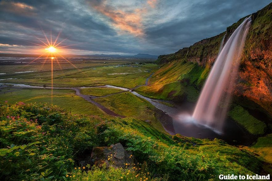 Seljalandsfoss waterfall, in the light of the midnight sun