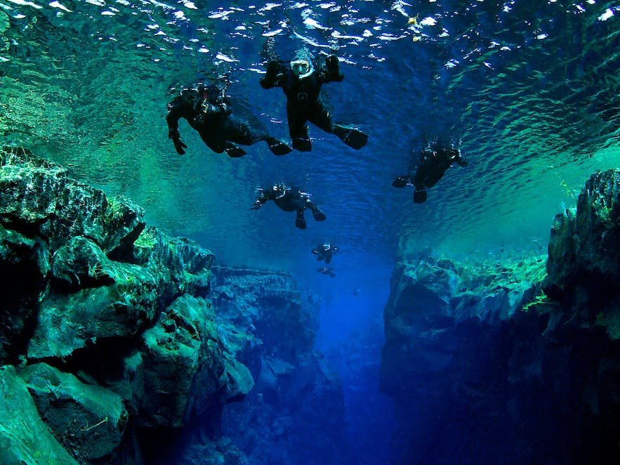 Snorkellers floating over 'The Cathedral' in Silfra Fissure.