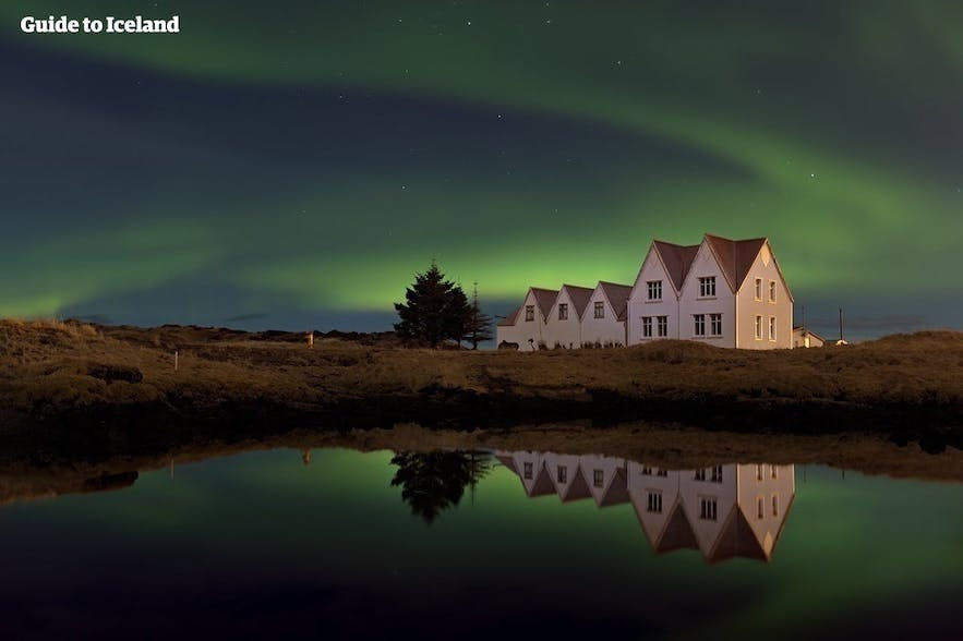 Northern Lights over two houses in the Reykjavik area, Iceland