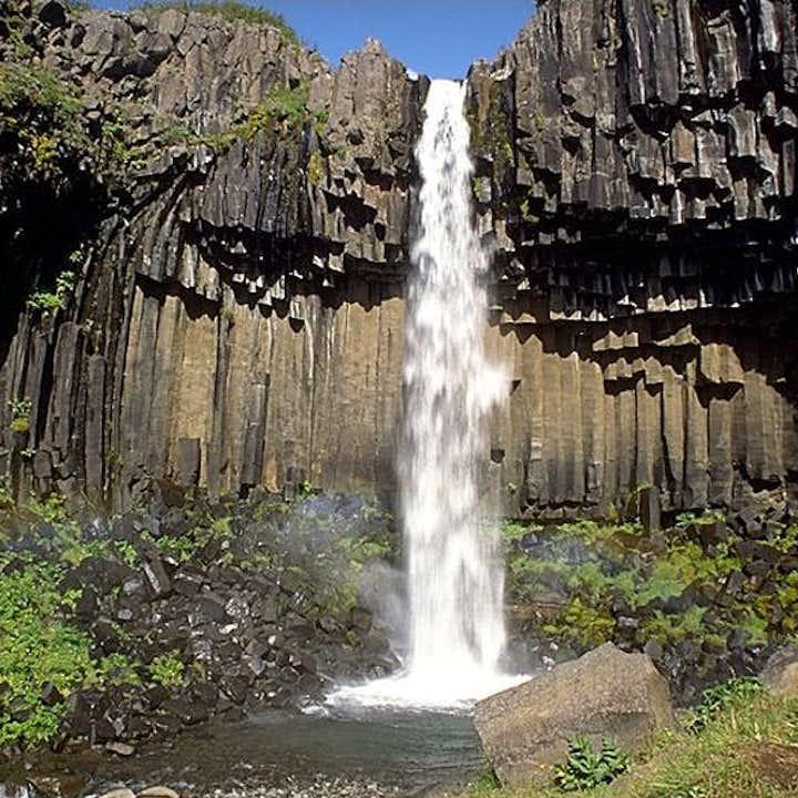 Svartifoss, found in Skaftafell Nature Reserve, is surround by dark basalt columns.