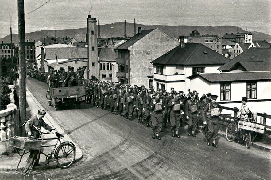 British troops marching through the capital, Reykjavik, following their tactical invasion of Iceland.