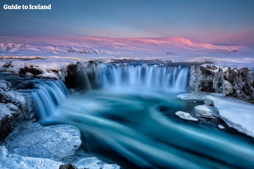Goðafoss waterfall sits between Akureyri and Mývatn.