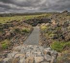 The alluring entrance of the lava tunnel Raufarhólshellir Cave in South Iceland.