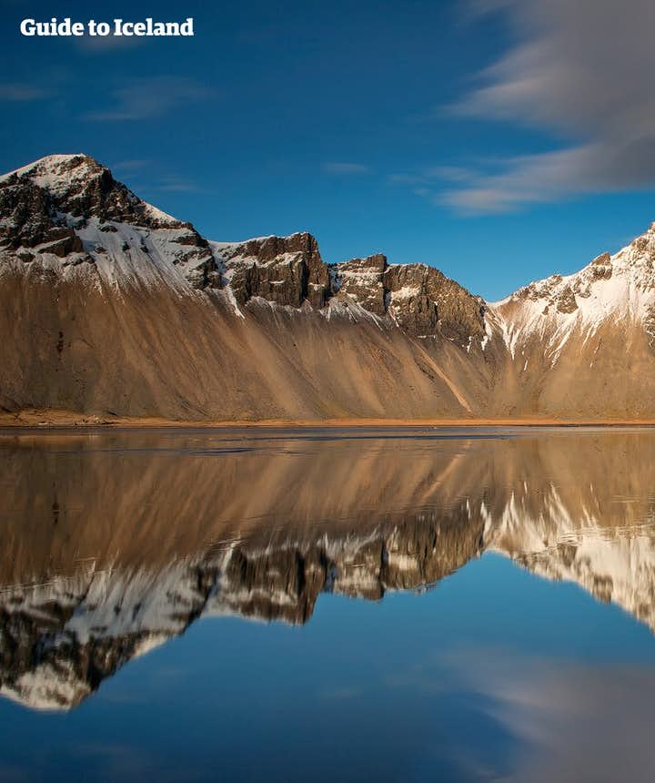 Perfect reflection of a perfect mountain on a perfect beach