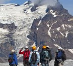 Tall mountain peaks can be seen on a glacier hiking tour