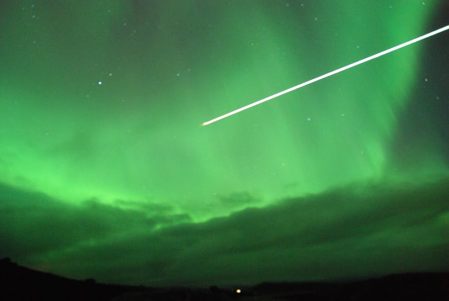 Meteor flying through the auroras in North Iceland