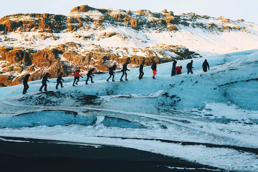 A line of glacier hikers in winter