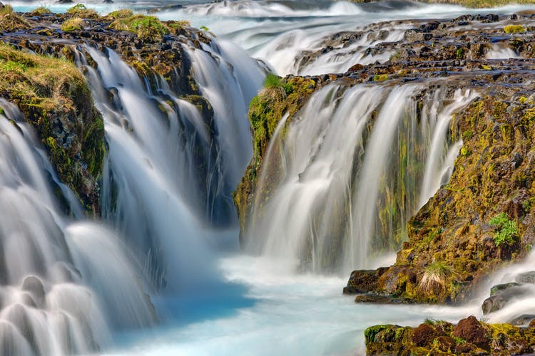 West Iceland offers amazing waterfalls such as Barnafoss and Hraunfossar.