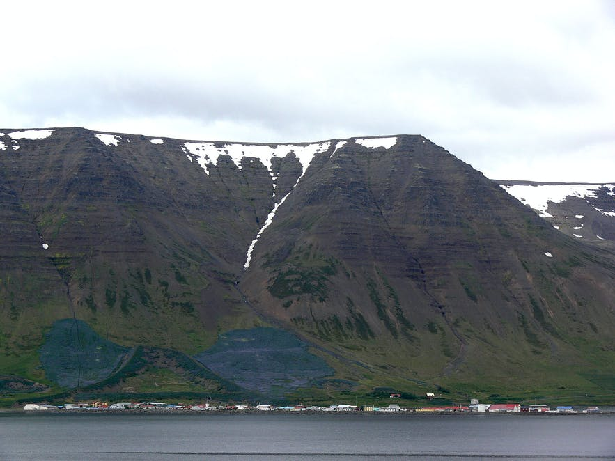 Flateyri, overshadowed by an enormous mountain
