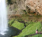 In summer, under good conditions, visitors to the South Coast can fully encircle the waterfall Seljalandsfoss.