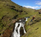 The zipline in South Iceland shoots over a picturesque waterfall.
