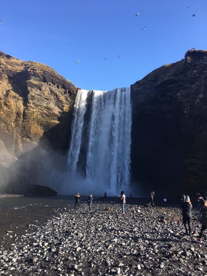 Skógafoss is one of the many waterfalls in Iceland's south fed by a glacier river.