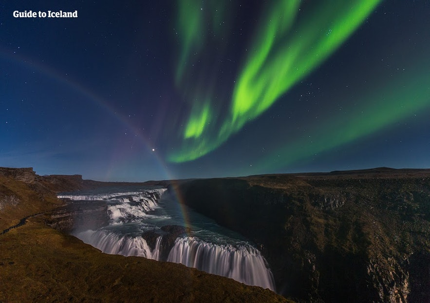 Gullfoss waterfall with a rainbow and the Northern Lights dancing above
