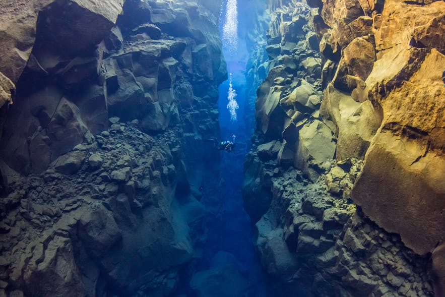 Diving in Silfra fissure in Iceland