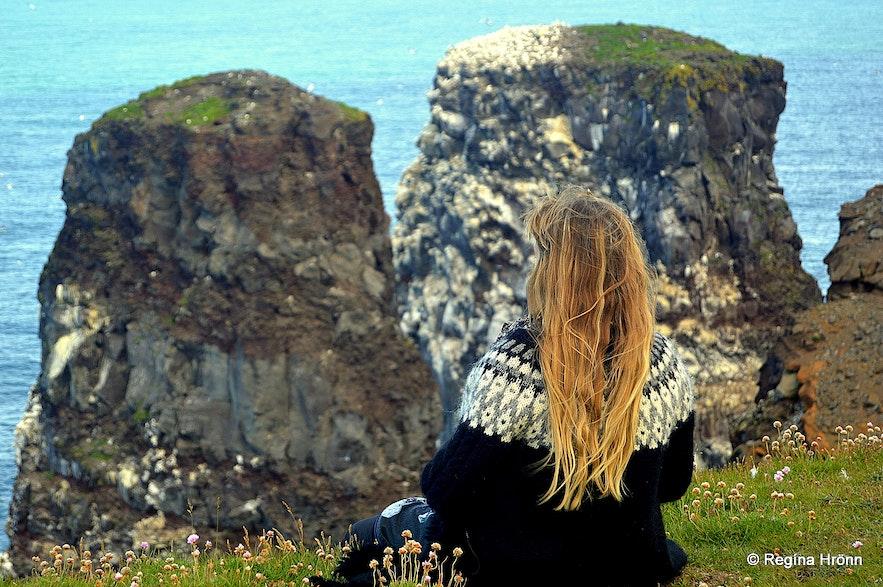 Regína admiring the sea-stacks at Rauðinúpur