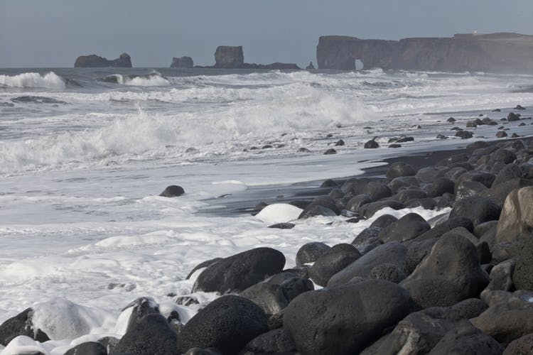 The distinctive coastline of the South Coast. Reynisfjara can be seen in the background.
