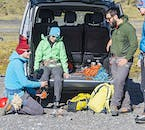 Your glacier guide will help you with crampons and helmets before you embark on a glacier hike in Iceland.