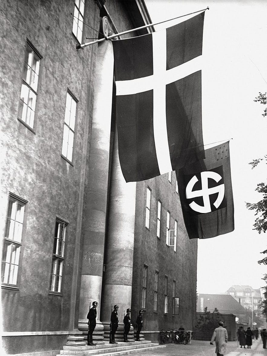 The flag of the Schalburg Corps, a branch of the Nazi SS, hanging beside the Danish one.