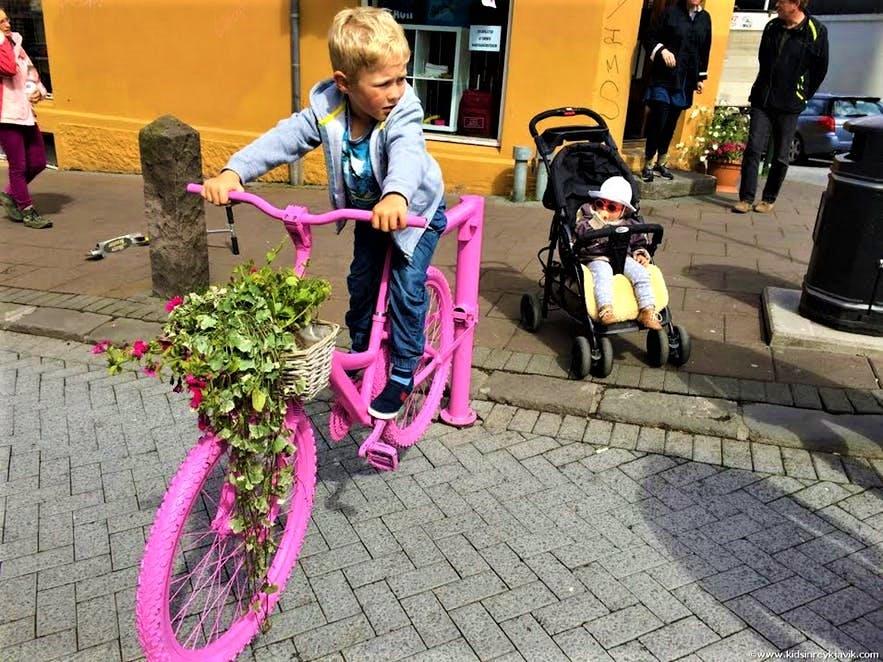 Kids at play on shopping street Laugavegur
