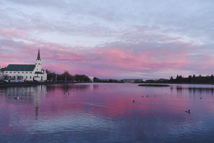 Tjörnin Pond under the Midnight Sun. Photo by Xiaochen Tian