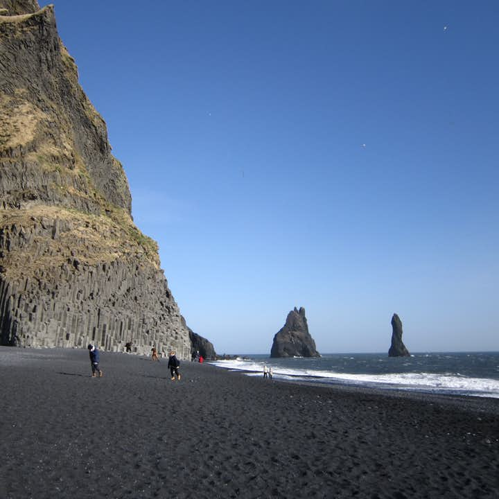 Reynisdrangar basalt cliffs in Reynisfjara black sand beach