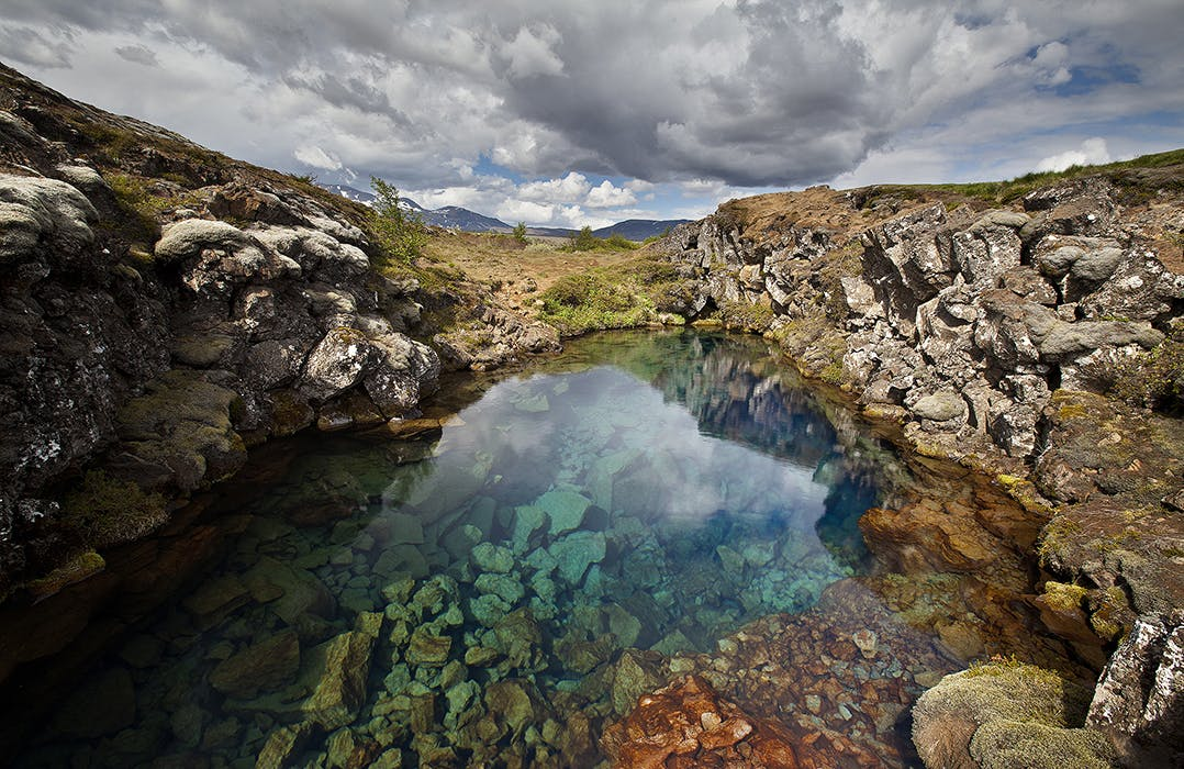 Near The Entrance To Silfra Fissure Guests Can Look Down Into Crystal Clear Glacial